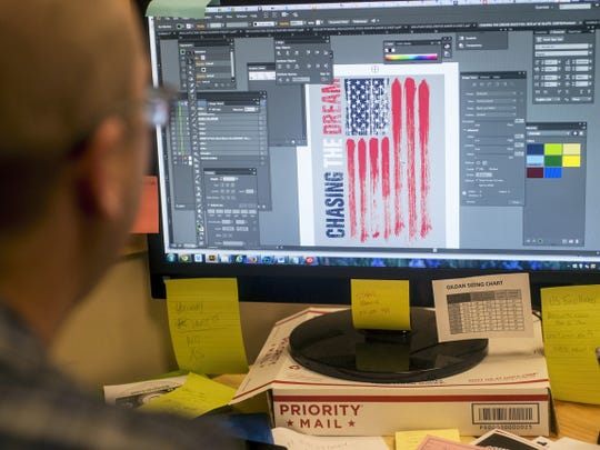 Teamzila Graphic Designer Mike Stearns works on one of the company's most popular USA Field Hockey designs.