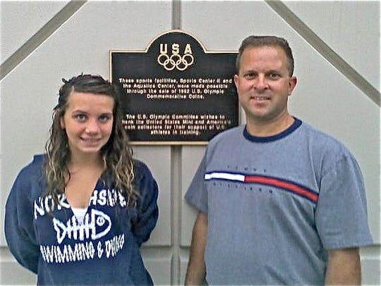Lizzi Smith stands beside her Cardinal Swim Club coach