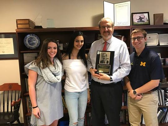 OldBridgeHighSchool alumniAisling O'Donnell, Ananya Ramanathan and Dylan Schwartzmet with Mark Schlissel, the president of theUniversity of Michigan, to officially induct him into the high school's Wall of Fame, Class of 2017.