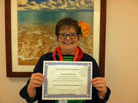 Cindy Weatherall with her certificate of completion.
