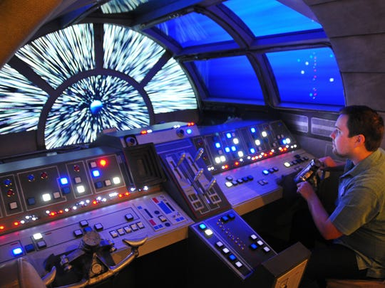 Disney Cruise Lines has made exciting upgrades to the Disney Dream including Vanellope's Sweet Shop and the Ocean Club featuring themed play rooms including Toy Story, Infinity Room and a Star Wars Millennium Falcon. Danny Handke, creative designer lead with Walt Disney Engineering takes a turn flying the Millenium Falcon. He was lead designer for the project.