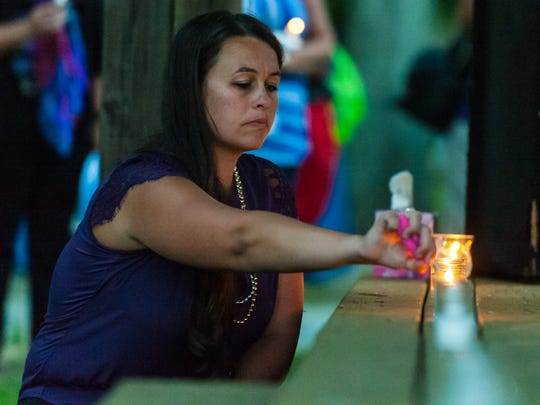 Candles were lit for 37 deceased area residents during