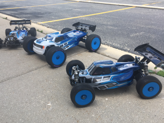 Remote-controlled cars are ready to rumble on a racetrack