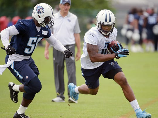 The open Titans practices are a good way to get to know the team pre-season,  and pick up some autographs too. Titans defensive coordinator Dick LeBeau, center, watches linebacker Nate Palmer (50) and running back Derrick Henry (2) run one-on-one drills during practice at Saint Thomas Sports Park last year.
