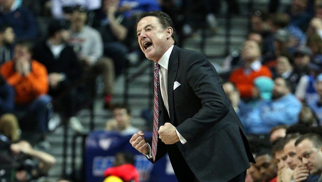 Louisville Cardinals head coach Rick Pitino coaches against the Duke Blue Devils during the second half of an ACC Conference Tournament game at Barclays Center.