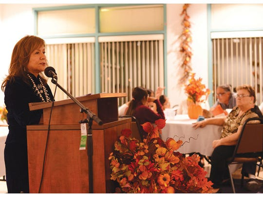 Arizona State University professor and New Mexico native Dr. Laura Tohe addresses a crowd of more than 50 people after being inducted as the Navajo Nation poet laureate on Sept. 11 in the Hospitality Center of Navajo Technical University in Crownpoint.