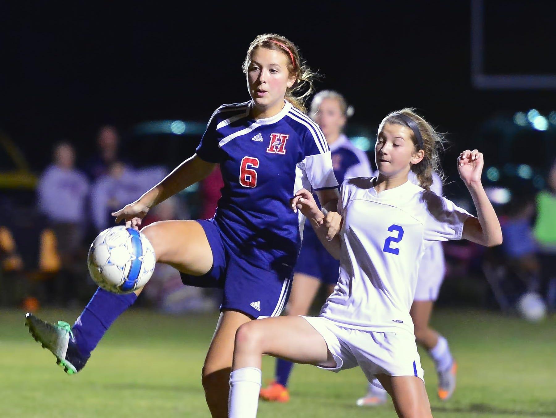 White House High freshman midfielder Shelby Deering (2) battles for possession with White House Heritage junior Sky Baker.