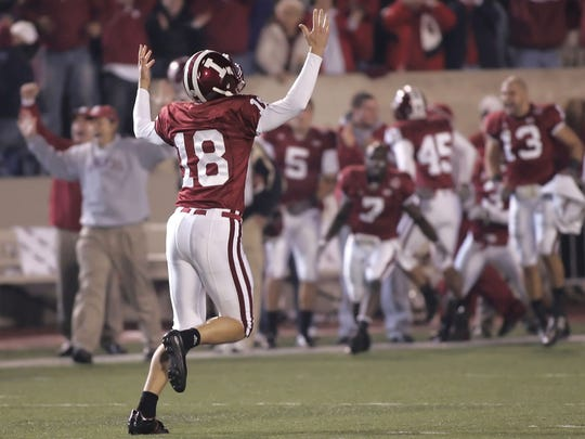 Austin Starr runs to the Hoosier bench after his field
