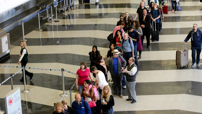 A long line of travelers waiting for the TSA security check point at O'Hare International airport in Chicago.