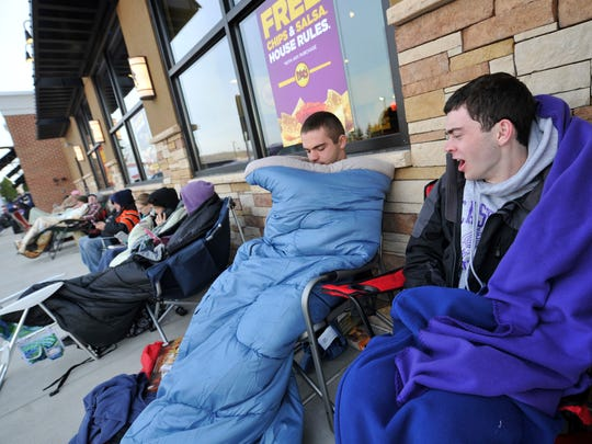 Patrick Walsh, left, lets out a yawn after he and Joseph McShea of Akron, Pa., waited overnight for the opening of Moe's Southwest Grill in Springettsbury Township. The duo were the first in line, showing up at 7:20 p.m. the night before to wait for their free lunch and a coupon book for a year's worth of free burritos.