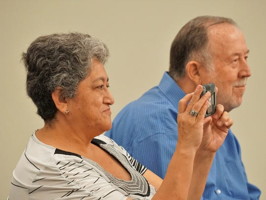 Marta Chavez, left, takes a photo of retiring Tuloso-Midway