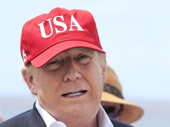 President Donald Trump speaks to reporters during a visit to Lake Okeechobee and Herbert Hoover Dike at Canal Point, Fla., Friday, March 29, 2019.