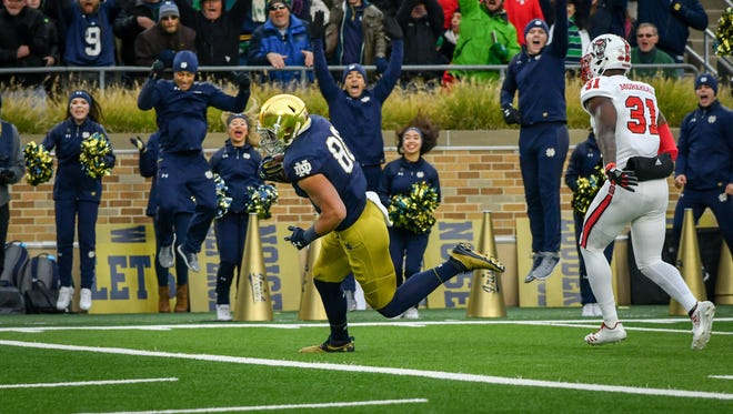 Oct 28, 2017; South Bend, IN, USA; Notre Dame Fighting Irish tight end Durham Smythe (80) catches a pass for a touchdown as North Carolina State Wolfpack safety Jarius Morehead (31) defends in the first quarter at Notre Dame Stadium. Mandatory Credit: Matt Cashore-USA TODAY Sports