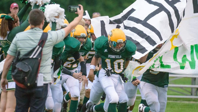 The Pennfield Panthers take the field as they face off against the Coldwater Cardinals Friday night.