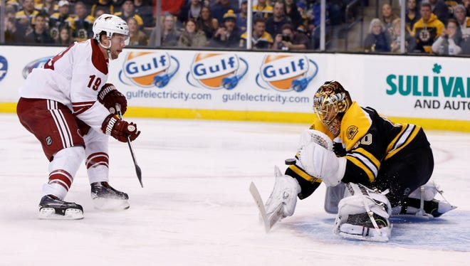March 13, 2014 - Boston Bruins goalie Tuukka Rask (40) saves a shot by Phoenix Coyotes right wing Shane Doan (19) during the second period at TD Banknorth Garden.