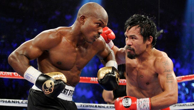 Manny Pacquiao, right, and Timothy Bradley exchange punches during their WBO welterweight title fight in Las Vegas in 2012. Nearly two years after Bradley won in a disputed split decision, the two will fight again on April 12.