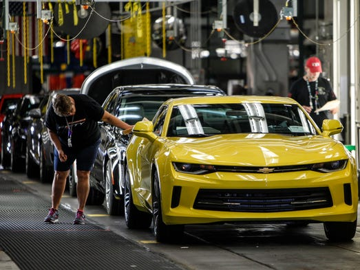 Workers at the end of the line inspect a 2018 Camaro