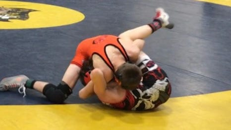 Brighton's Ben Manly (top) improved to 27-5 with a pin against Richmond