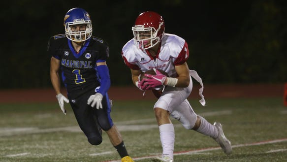 North Rockland's Dylan Senatore (1) catches a first