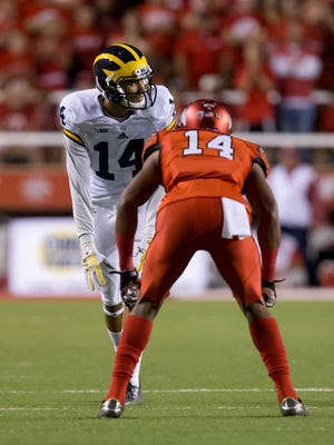 Michigan wide receiver Drake Harris (14) lines up opposite Utah defensive back Brian Allen.