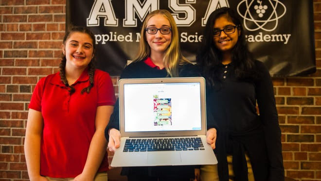 "Hannah Tamagni, Liakadja Whitesell and Nishi Gupta show off their "" Eating Green"" App, which won the Fourth Annual Congressional App Challenge, hosted by Rep. Frank LoBiondo."