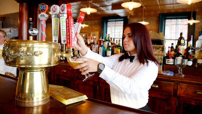 Erin Ross, bartender at Bay Horse Cafe pours Hudy Delight beer. The historic Downtown beer saloon is reopening July 5 at 625 Main St.