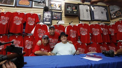 Pete Rose with Reds fans in Cooperstown in July 2012.