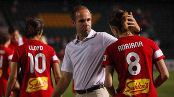 WNY Flash coach Aaran Lines, middle, said Spanish forward Adriana Martin was one of the players who came up big in Sunday's 3-1 season-opening win in Washington.
