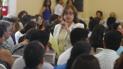 Attorney Anita Delgado talks to members of the White Plans immigrant community during a meeting about the Dream Act at El Centro Hispano of White Plains in 2012.