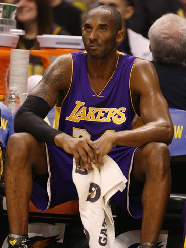Los Angeles Lakers guard Kobe Bryant (8) is still holding