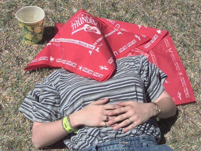 Ambra Lederle of Phoenix takes a nap inbetween acts