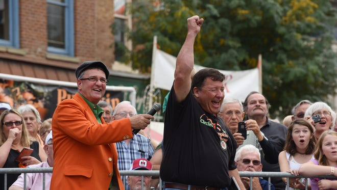 Cecil Weston punches the air in celebration after his pumpkin was weighed in at the annual Circleville Pumpkin Show Wednesday morning in downtown Circleville. Weston's pumpkin won the giant pumpkin weigh-in contest with a weight of 1,553.5 pounds.