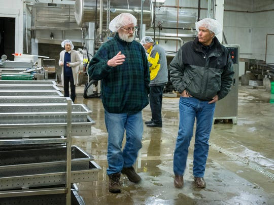 Bob Rees, a 59-year-old Des Moines inventor, left, and Rick Kimberley, soybean farmer from Maxwell, tour Iowa Food Manufacture, a tofu plant near Water Works Park in Des Moines Friday, Jan. 27, 2017.