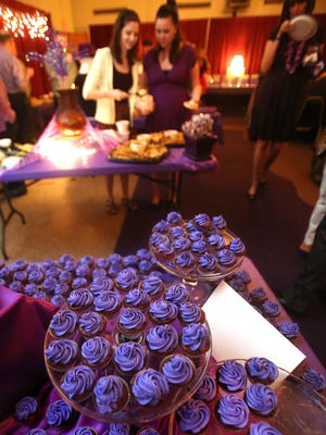 Purple frosting adorned cupcakes in the food buffet at Purple Craze in 2013.
