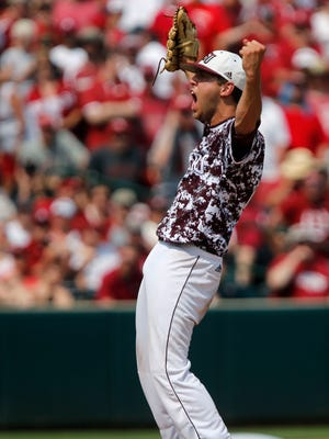 Missouri State starting pitcher Matt Hall celebrates after the last out during the NCAA Division I Baseball Super Regional against the Arkansas Razorbacks in Fayetteville, Ark. on Saturday, June 6, 2015. Hall pitched a complete game giving up only one run to the Razorbacks.