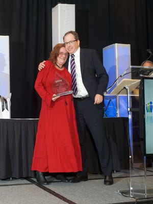 Bette Legory with David Wright, of Xerox, when Legory received the Employee of the Year award.