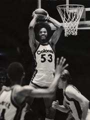 Kentucky Colonels center Artis Gilmore snatches a rebound in a game against the Virginia Squires at Freedom Hall in 1975. The ABA's Kentucky Colonels weren't included in the ABA-NBA merger and folded in 1976, leaving Louisville and Kentucky without a professional basketball team since.