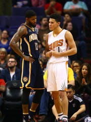 Could the Suns pair Paul George (left) with Devin Booker?