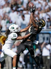 Western Michigan cornerback Darius Phillips intercepts a pass intended for Michigan State wide receiver Felton Davis III during the first quarter on Saturday, Sept. 9, 2017, in East Lansing.