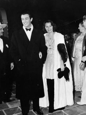 """From left: Robert Ransom, Robert Taylor, Barbara Stanwyck, unidentified woman and Earle Strebe attend the world premiere of """"Camille"""" at the Plaza Theatre in Palm Springs."""