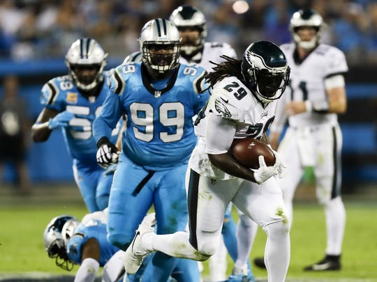 Philadelphia Eagles running back LeGarrette Blount runs past Carolina Panthers defensive tackle Kawann Short during the first quarter at Bank of America Stadium in Charlotte, N.C., on Oct. 12, 2017.