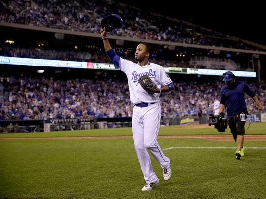 Kansas City Royals' Alcides Escobar acknowledges the crowd as he comes out of a baseball game during the seventh inning gainst the Arizona Diamondbacks, Saturday, Sept. 30, 2017, in Kansas City, Mo. (AP Photo/Charlie Riedel)
