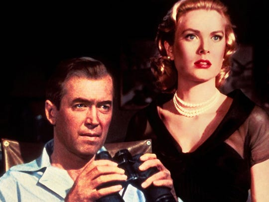 "Jimmy Stewart (left) sits next to Grace Kelly during the shooting of ""Rear Window."""