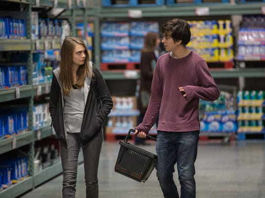 "This photo provided by Twentieth Century Fox shows Cara Delevingne, left, as Margo, and Nat Wolff as Quentin, in a scene from the film, ""Paper Towns.""  (Michael Tackett/Twentieth Century Fox via AP)"