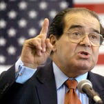 In this Wednesday, April 7, 2004 file photo, U.S. Supreme Court Justice Antonin Scalia speaks to Presbyterian Christian High School students in Hattiesburg, Miss. On Saturday, Feb. 13, 2016, the U.S. Marshals Service confirmed that Scalia has died at the age of 79.