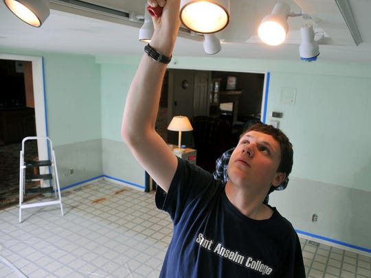 Saint Anselm College student Bradley Greenland, 20, of Merrimack, NH, helps paint the dining room at Elwyn's Baywood group home in Vineland, as a part of a service project for the college with Cumberland County Habitat for Humanity, Tuesday, Jan. 12.