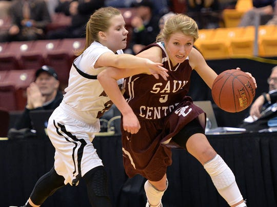 Sauk Centre sophomore Kelsey Peschel (5) drives the ball past Norwood-Young America junior Shyann Wickenhauser (2) during the first half of the Class 2A girls basketball tournament quarterfinal game Wednesday at the University of Minnesota's Mariucci Arena in Minneapolis. The Mainstreeters led Norwood-Young America 45-25 at halftime.