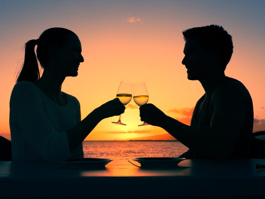 People celebrating drinking wine in a romantic setting.
