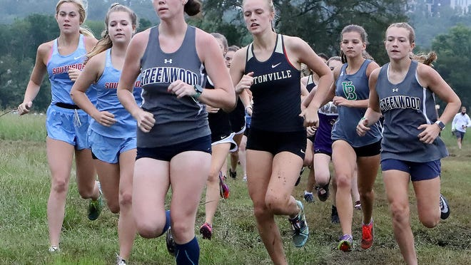 Greenwood's Macie Cash leads a group of runners, Saturday, Sept. 12, during the first mile of the UAFS/Fort Smith Invitational Cross Country meet at Ben Geren.
