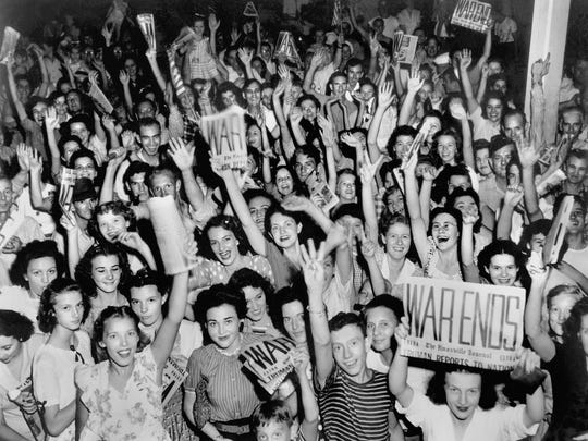 A shot of a joyous people in Jackson Square the celebrating at the end of World War II was taken by Oak Ridge photographer Ed Westcott. (ED WESTCOTT/DEPARTMENT OF ENERGY)